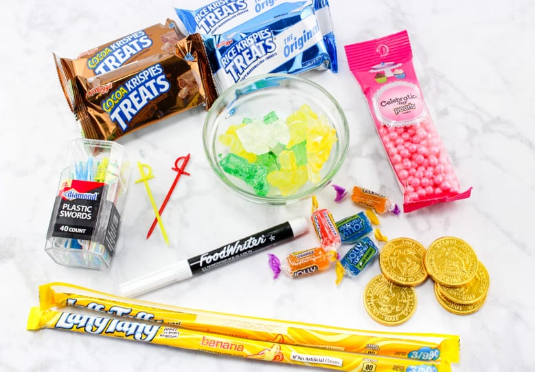 Rice Krispies Treats, Cocoa Krispies Treats, Laffy Taffy Rope, Rock Candy, Candy Pearls, Jolly Ranchers, Gold Coins, Edible Pen, and Toy swords