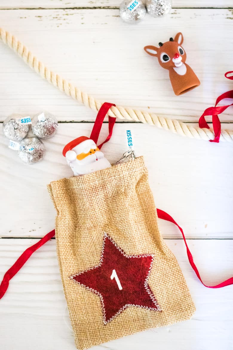 Advent Calendar day 1 bag with Santa toy and Hershey Kisses