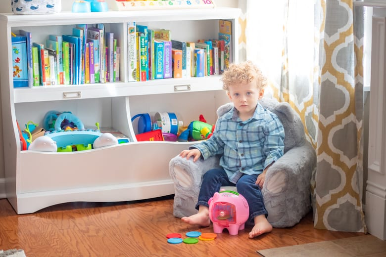 Toddler boy with piggy bank