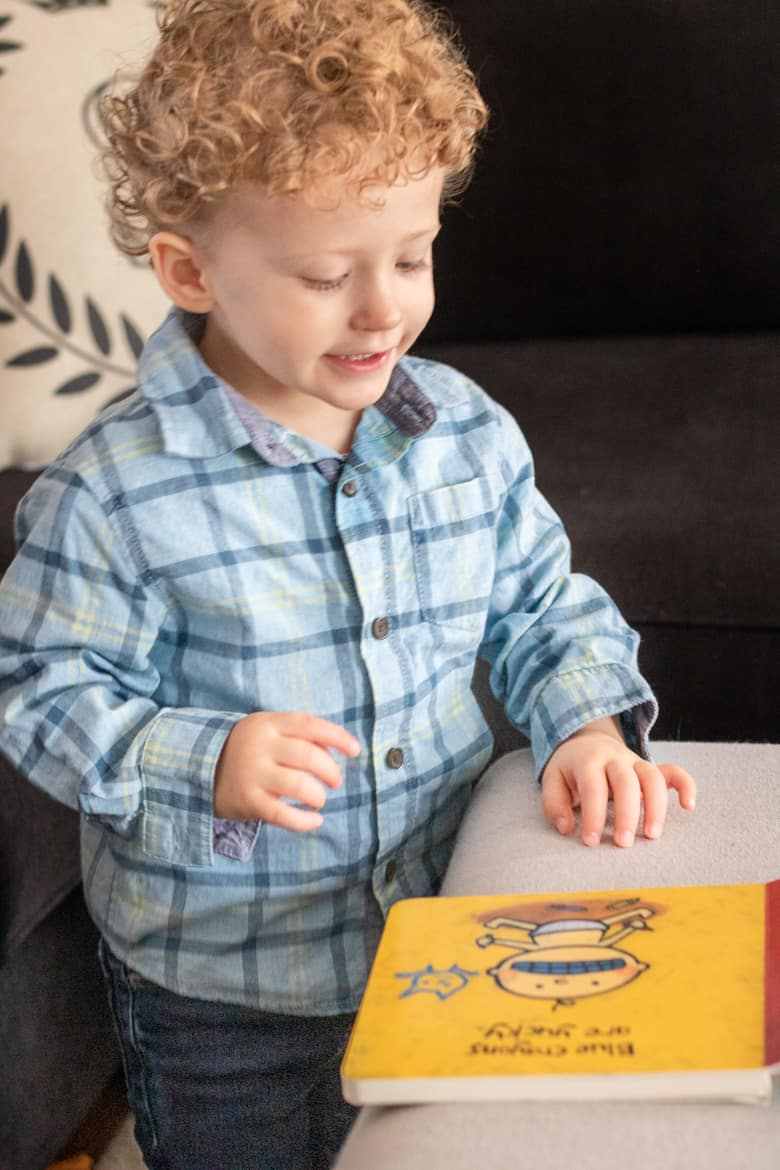 Toddler looking at board book