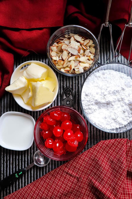 butter, cherries, slivered almonds, powdered sugar, milk