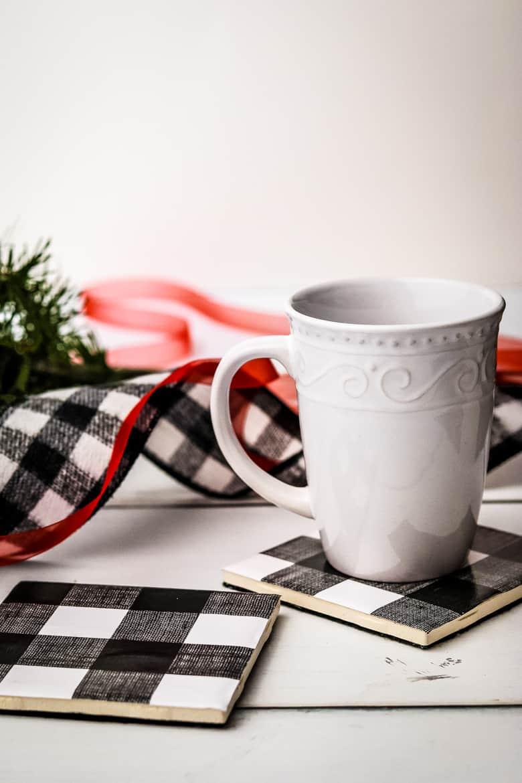 Buffalo Check coasters, one with a white mug on top