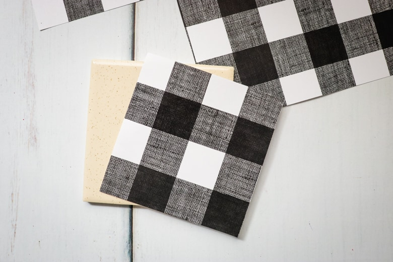 Piece of scrapbook paper cut to size of tile