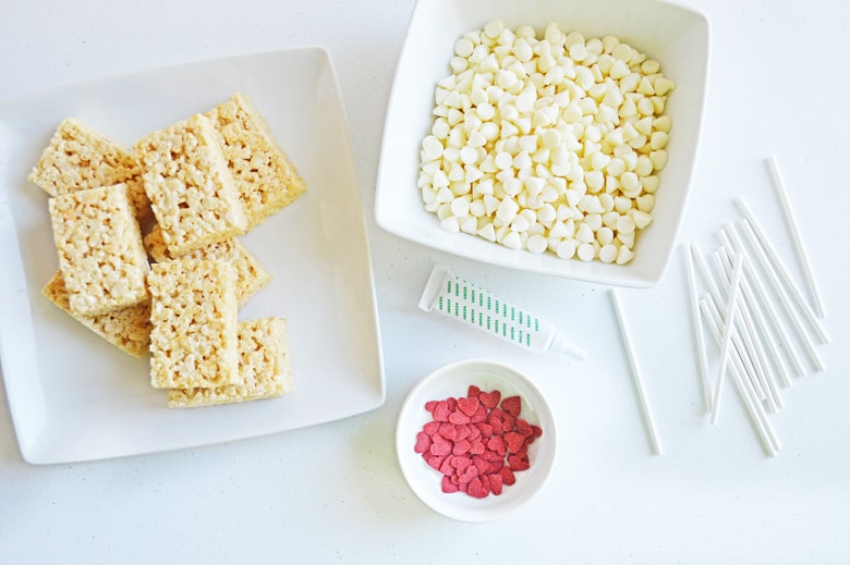 white chocolate chips, red heart sprinkles, and unwrapped rice cereal treats