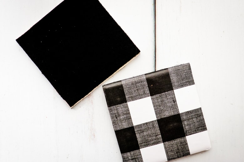 Two tile coasters, one upside down to show black felt glued on