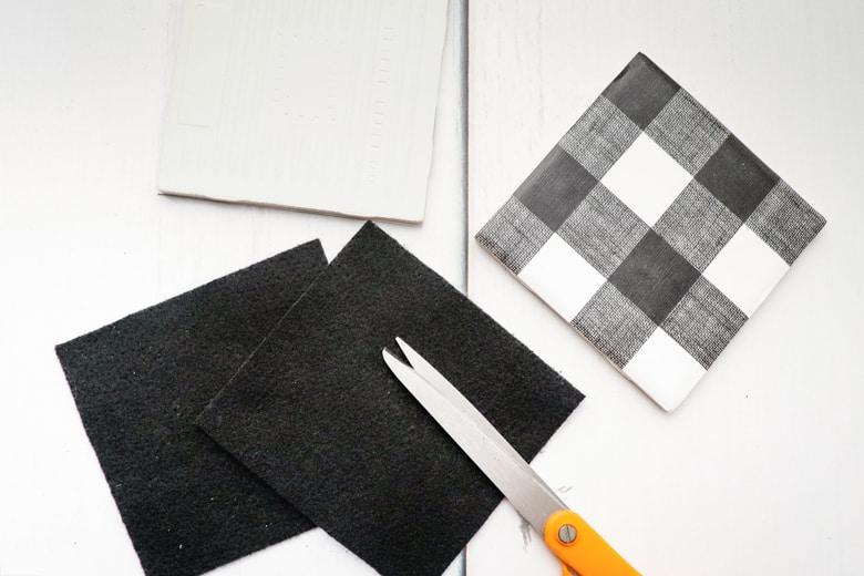 Felt squares trimmed to fit under tile coaster