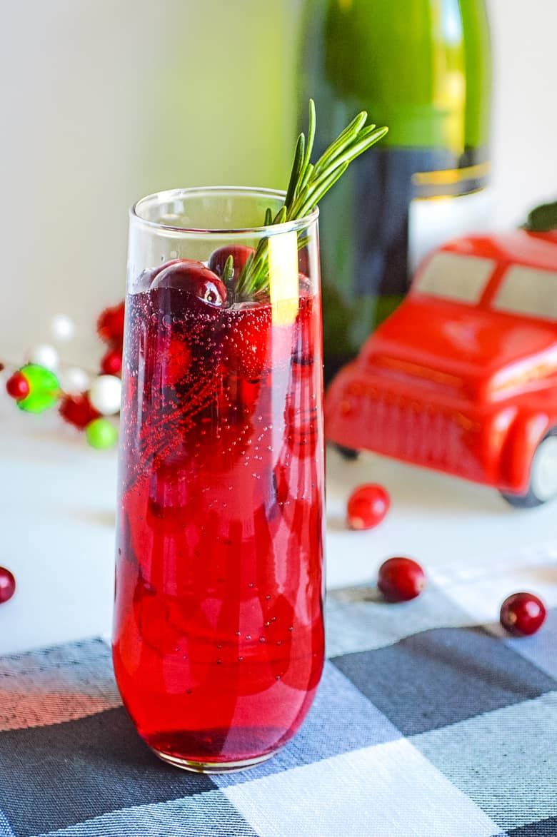 christmas cranberry mimosa sitting on a table