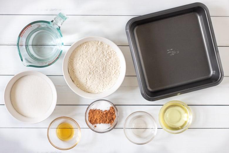 flour, cocoa, sugar, water, oil, vanilla, vinegar, salt, baking soda, and square pan