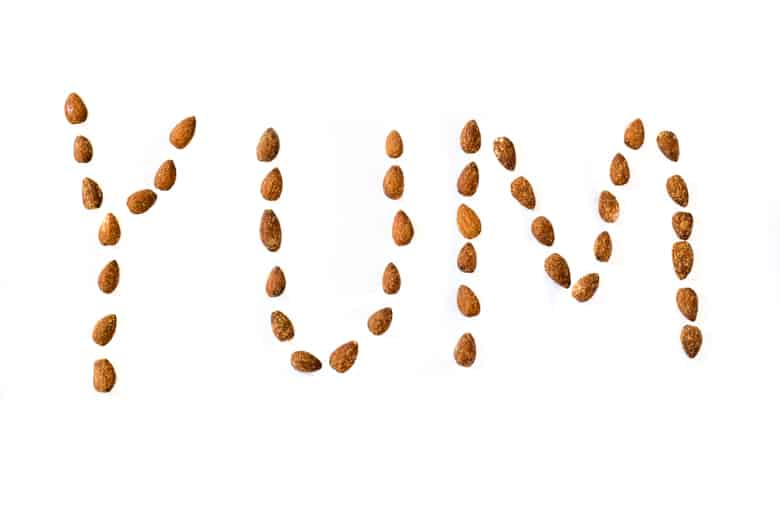 "The word ""Yum"" spelled out with almonds"
