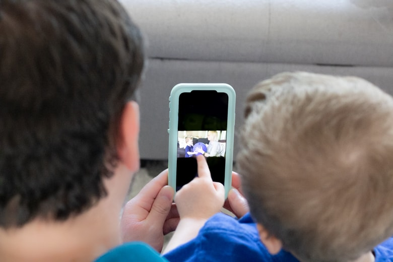 Father and son looking at photo on iphone