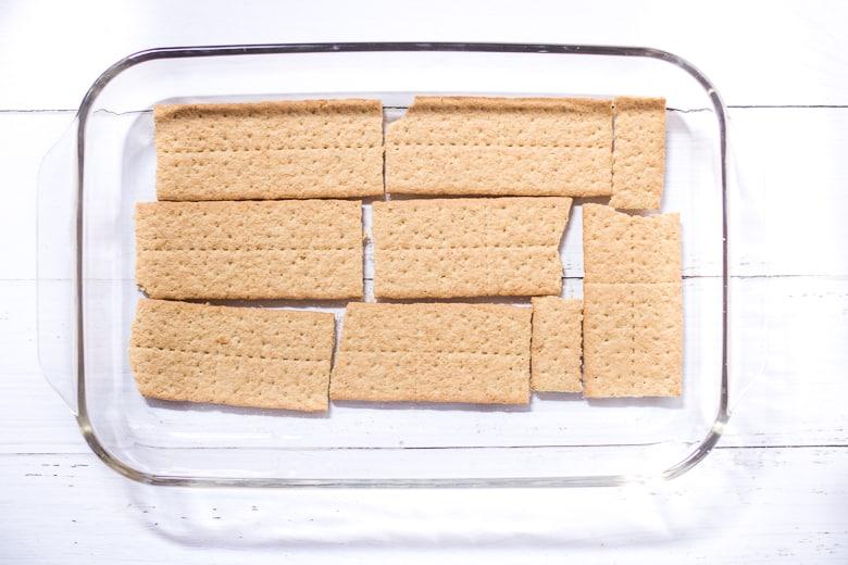 graham crackers layered on bottom of 9 x 13 baking dish