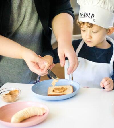 Making peanut butter and banana sandwich