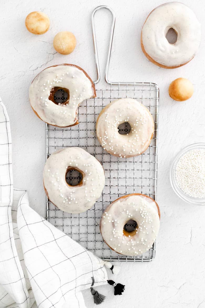 air fryer donuts made from scratch with vanilla icing and sprinkles