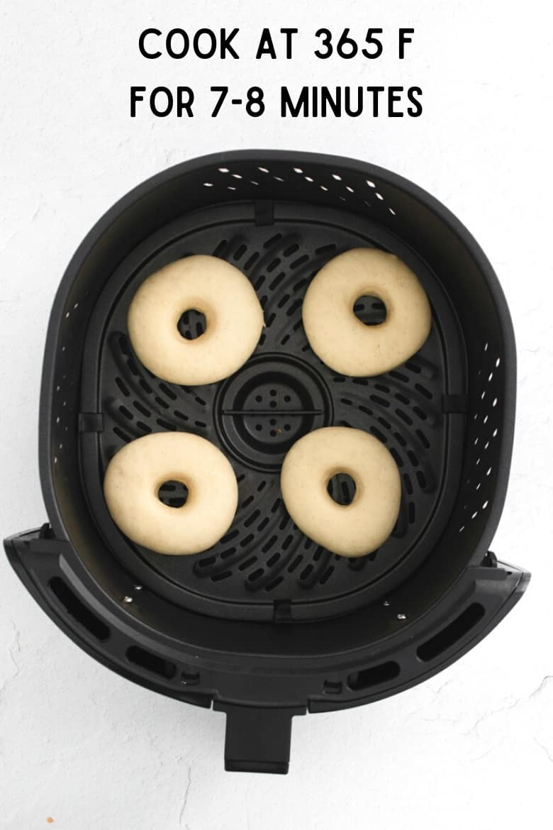 image of donuts in air fryer basket; reads: cook at 365 F for 7-8 minutes