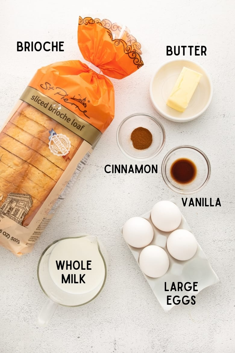 Loaf of sliced brioche bread, about 2/3 of a stick of butter, ground cinnamon, vanilla extract, 4 large eggs, and a measuring cup filled with whole milk
