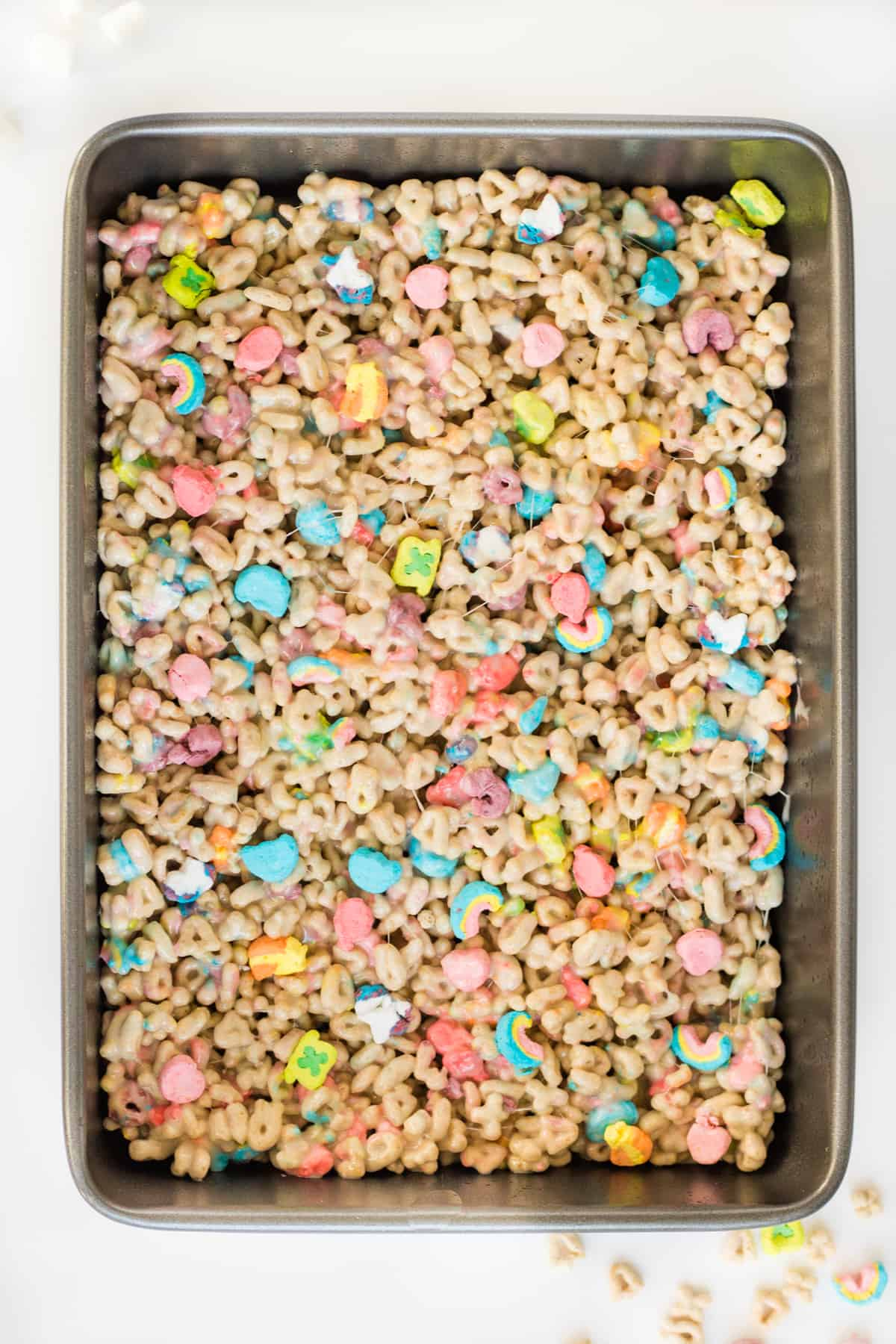9 x 13 inch baking pan with Lucky Charms treats still uncut in it