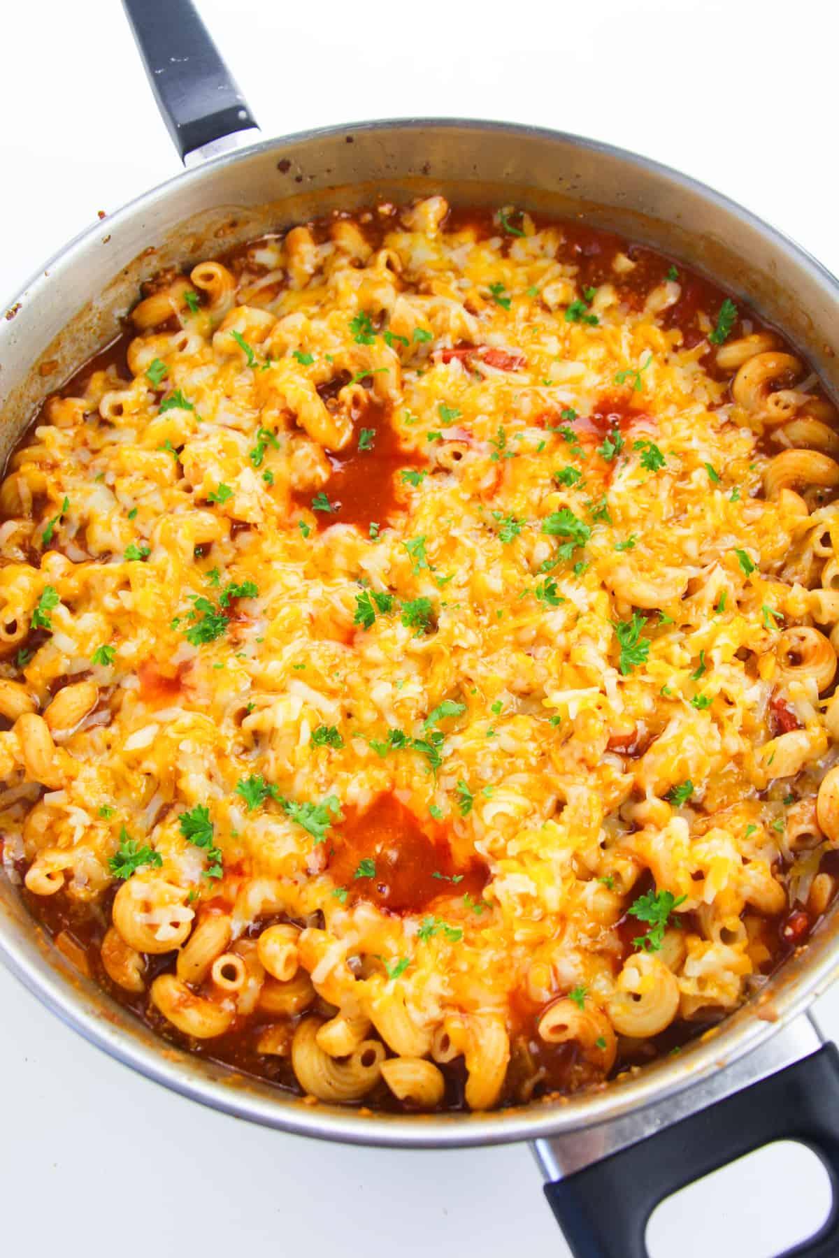 overhead image of skillet of enchilada pasta