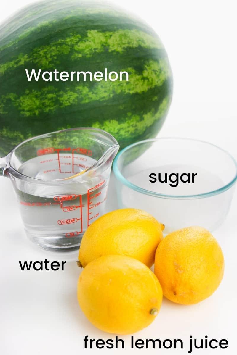 watermelon, measuring cup of water, bowl of sugar, 3 lemons