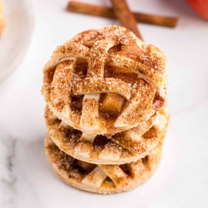 Apple pie cookies stacked on top of one another