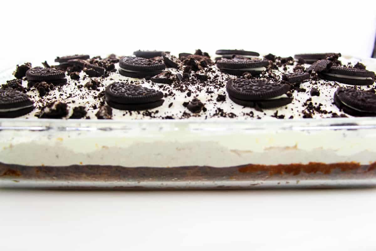 Oreo poke cake in glass casserole baking dish