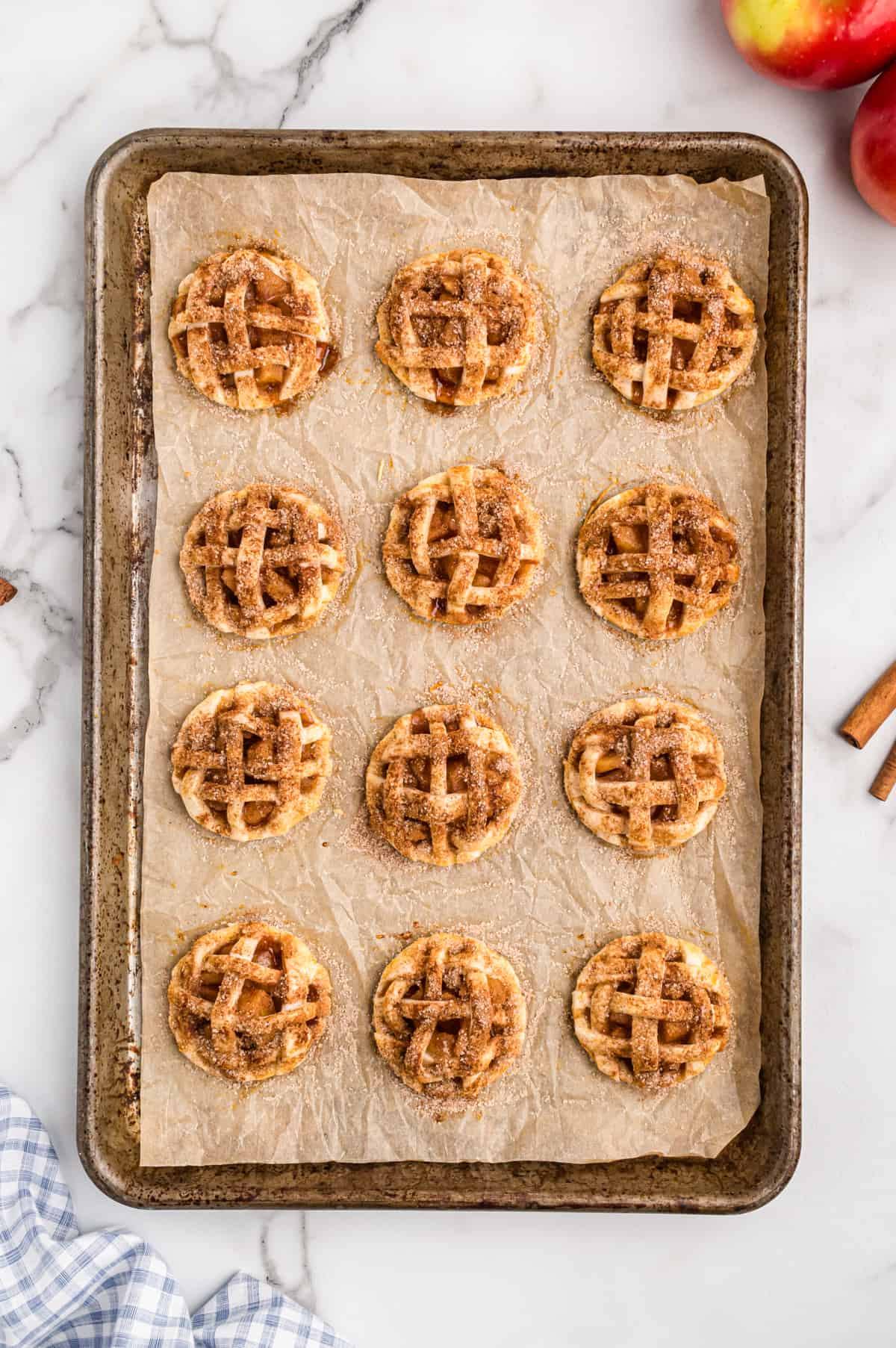 Mini apple pie cookies on baking sheet fresh from the oven