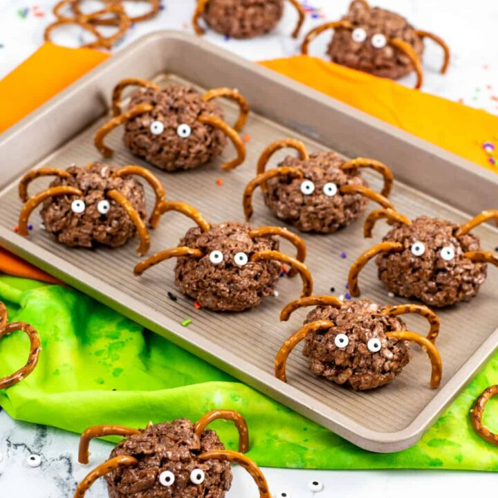 Chocolate rice krispies spider treats with pretzel legs and candy eyes